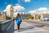 London city urban lifestyle tourist woman walking. Businesswoman commuting going to work on Westminster bridge street early morning. Europe travel destination, England, Great Britain, UK. poster