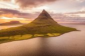 Iceland nature Kirkjufell mountain landscape in West Iceland on the Snaefellsnes peninsula. Icon of Iceland travel and most photographed icelandic mountain. drone aerial view from above. poster