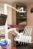 Interior of modern dental clinic office with dental unit equipment computer monitor screen and instruments. Concept of stomatology. poster