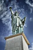Replica of the Statue of Liberty on the Ile aux Cygnes Paris - HDR image. poster