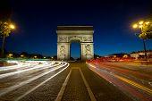 Paris Arc de Triomphe Triumphal Arch at Chaps Elysees at night, Paris, France. Architecture and landmarks of Paris. Postcard of Paris poster