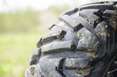 Dirty protector tire. Mud tire ATV. Selective focus. poster