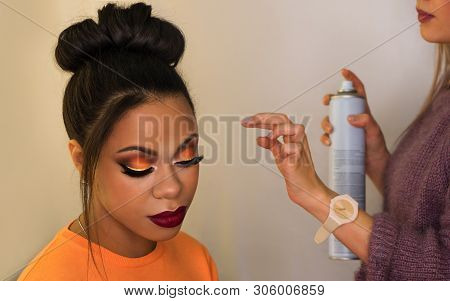 Young Woman African American With Perfect Skin Facial. Fashion Luxury Makeup Orange-coloured Shades.