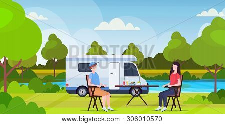 Couple Sitting At Table Near Camping Family Trailer Truck Caravan Car Man Woman Spendingtime Togeher