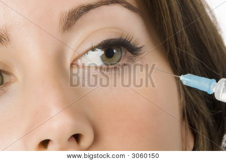 Portrait of fresh and beautiful woman getting injection poster