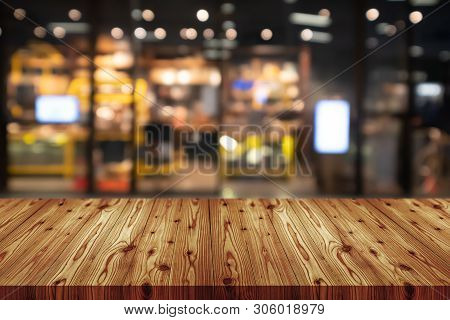 Empty Wooden Table Top With Blurred Of Department Store Background, Abstract Background Can Be Used
