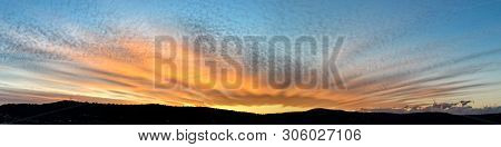 An Unusual And Striking Fan Shaped Orange Coloured Cirrocumulus Cloudy Tropical Sunset Panorama In A