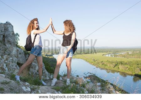 A World Without Borders. Stunning Journey Of Two Girls In The Mountains. Fitness In Nature. The Woma