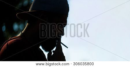Silhouette Of Bearded Man With Cigar. Beard Man And Mustache Smoke Cigar. Smoldering Cigars. Smoking