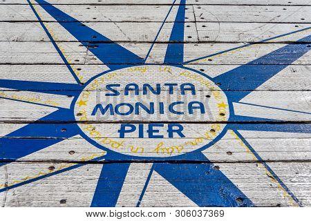 Santa Monica, CA, USA - July 27, 2018 - Sign on the floor of Santa Monica Pier says