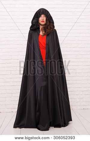 Scary But Iconic. A Woman Witch. Sexy Woman Wearing Halloween Costume On White Brickwall. Sensual Wo