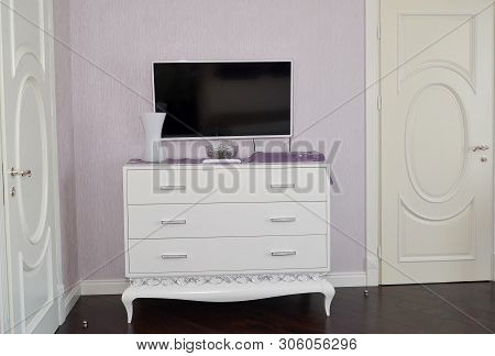 White dresser in a bedroom. Modern classics with rococo elements poster