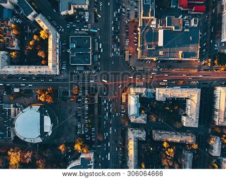 Aerial Top View Of City Asphalt Roads With Lot Of Vehicles Or Car Traffic And Buildings, Modern Urba