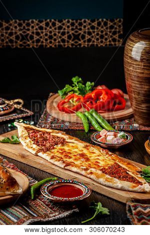 Traditional Turkish Cuisine. Turkish Pizza Pita With A Different Stuffing, Meat, Cheese, Slices Of V