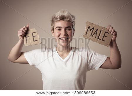 Transgender Teenager Breaking The Word Female Into Male. Gender Identity And Human Rights Concept.