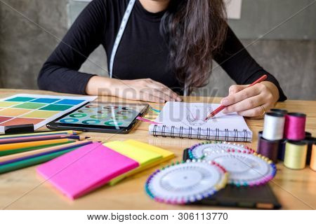 Young Woman Dressmaker Or Designer Working As Fashion Designers And Drawing Sketches For Clothes And