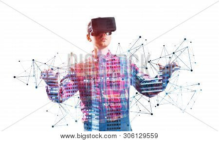 Young Man Wearing Vr Goggles And Gesturing In Virtual Reality. Guy Standing And Touching Air During