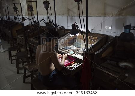 Bali, Indonesia - January 27, 2019: Unidentified Man Working In Silver Jewellry Factory At Bali, Ind