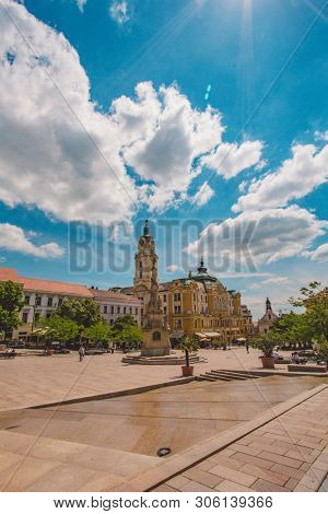PECS, HUNGARY - MAY 2019: View on people as they pass by on the pedestrian zone in the downtown of the city May 2019 in Pecs, Hungary