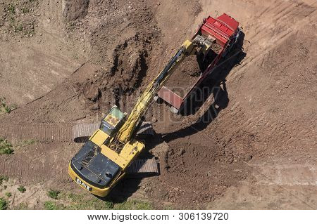 Toronto, Canada - June 11, 2019: Caterpillar Digging And Dumping Soil Into A Big Truck On A Construc
