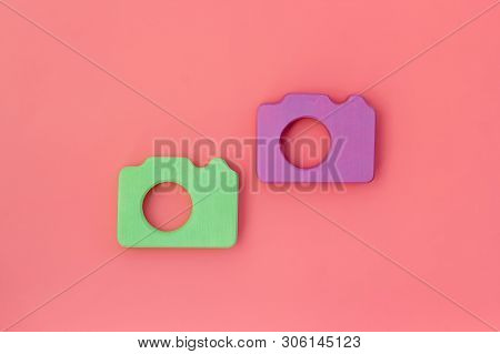 Photo Camera Concept On Pink Background Top View Copy Sace