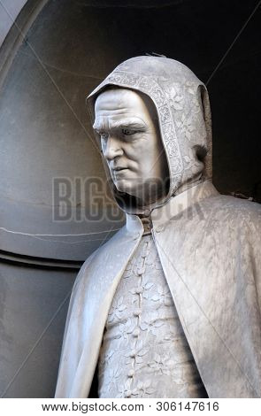 FLORENCE, ITALY - JANUARY 11, 2019: Giotto di Bondone in the Niches of the Uffizi Colonnade in Florence, Italy