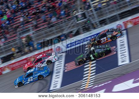 June 10, 2019 - Brooklyn, Michigan, USA: Kurt Busch (1) and Kyle Larson (42) race down the front stretch during the FireKeepers Casino 400 at Michigan International Speedway in Brooklyn, Michigan.