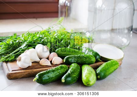 Conservation Of Fresh Green Cucumbers For The Winter. Preparation Marinated Salted Cucumbers With He