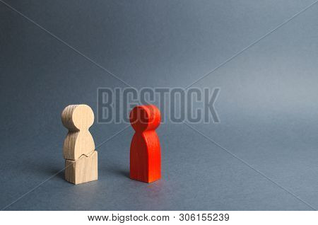 The Red Figure Of The Person Contacts To The Cracked Person Figure. Psychological Pressure, Physical