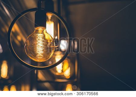 Vintage Tungsten Filament Multiple Lamps Of Different Size Hanging From The Ceiling. Interior Design