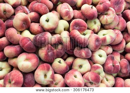 Group Of Flat Peaches On A Heap