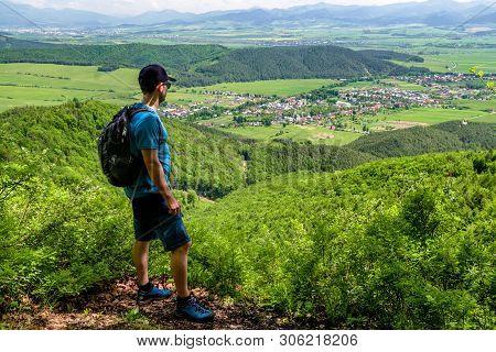 Hiker Looking At Village Klastor Pod Znievom, Slovakia