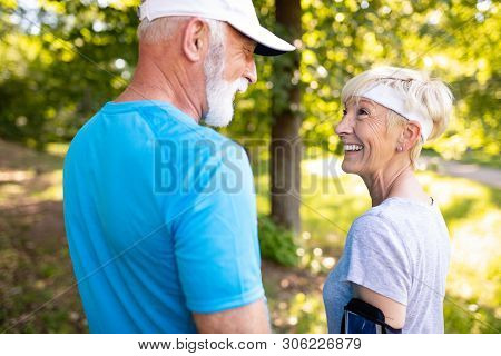 Happy Senior People Running To Stay Helathy And Lose Weight