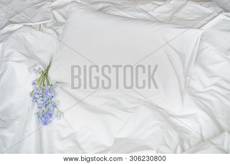 Flowers On The Messy Bed, White Bedding Items And Blue Flowers Bouqet