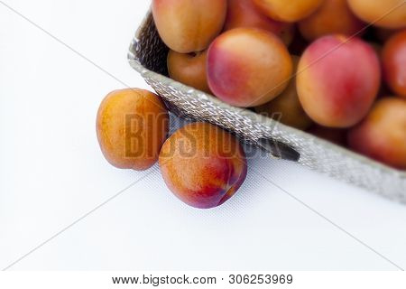 Fresh Organic Apricots In A Natural Fiber Box On White Background. Variety: Galta Roja, Bulida. Othe