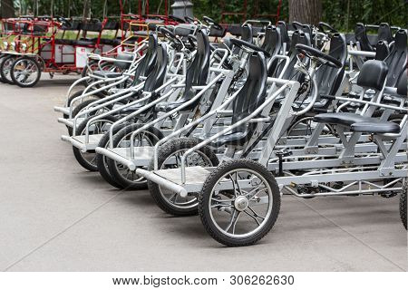 Bicycles For Rent Steel Black Pedal. Parked Rental Tourist Trike Vehicles Velomobiles. Ecological Tr