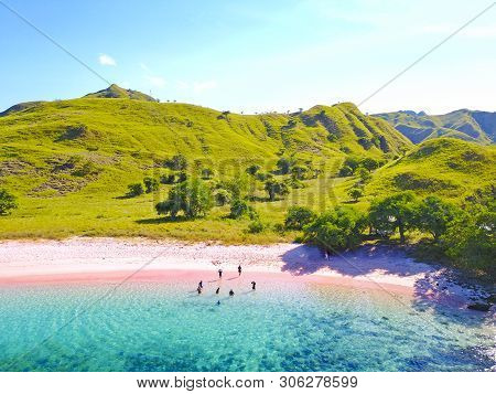 Aerial View Of A Pink Beach In Flores, With A Tourist And A Yatch