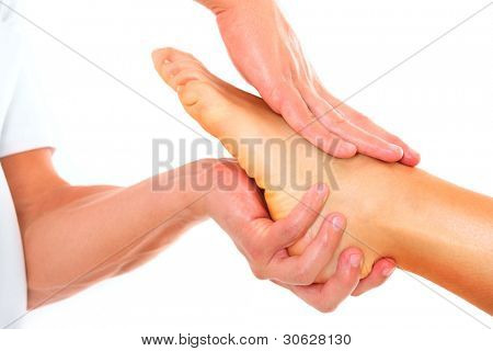A picture of a physio therapist giving a foot massage over white background