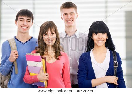 Young students looking at camera and smiling