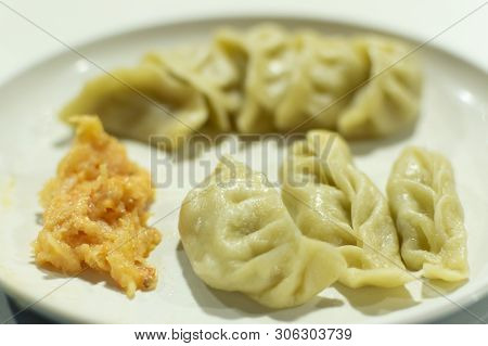Momo Is A Type Of South Asian Dumpling; Native To Tibet, Nepal, Bhutan And Sikkim. It Is Similar To