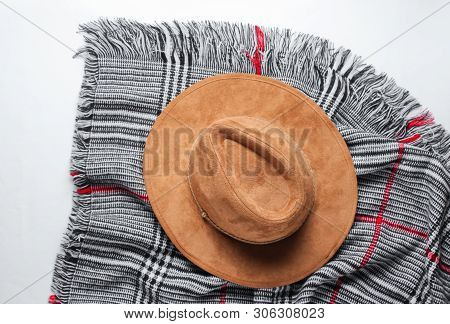 Felt Hat On The Scarf On A White Background. Top View