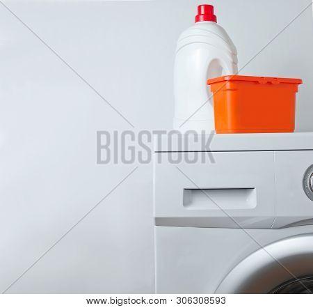 Bottle Of Washing Gel, Box Of Powder On Washing Machine.