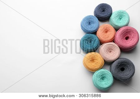 Clews Of Colorful Knitting Threads On White Background, Top View