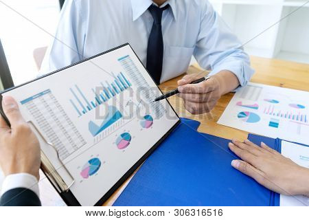 Business Businessman In Meeting Analyses Chart Graphy