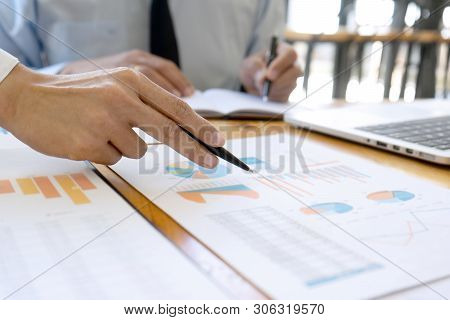 business businessman and woman in meeting analyses chart graphy marketing plan in business project poster