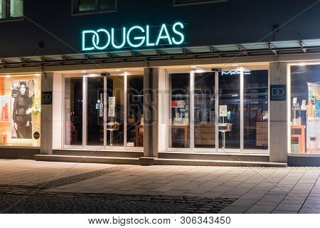 Bregenz, Austria - May 31, 2019: Entrance To Douglas At Night. Douglas Is An Internationally Operati