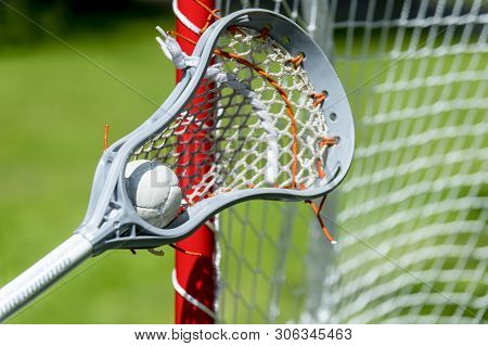 Abstract View Of A Lacrosse Stick Scooping Up A Ball