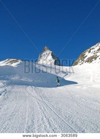 Snowboarder And Top Of Matterhorn