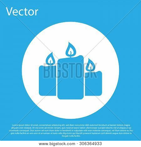Blue Burning Candles Icon Isolated On Blue Background. Old Fashioned Lit Candles. Cylindrical Aromat
