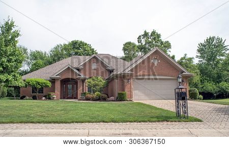 Deluxe Executive Red Brick House with Cobblestone Drive